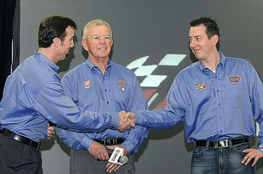 J. D. Gibbs, left, president of Joe Gibbs Racing, shakes hands with driver Kyle Busch as team owner Joe Gibbs watches, during a stop in the NASCAR Media Tour in Concord, N.C., Monday, Jan. 18, 2010. The team signed Busch to a long-term extension. J.D. Gibbs said the deal has actually been signed for some time, but the team wanted the news out so it can focus on the upcoming year. Photo: Mike McCarn, AP