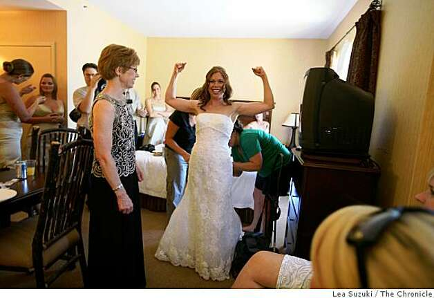 Carrie Shellhammer (center) flexes her arms while being helped into her wedding dress in her hotel room at the Hamilton Inn and Suites in Truckee, Calif. on Saturday, August 9, 2008. Her wedding to Zachary Chown was later that afternoon. Photo: Lea Suzuki, The Chronicle