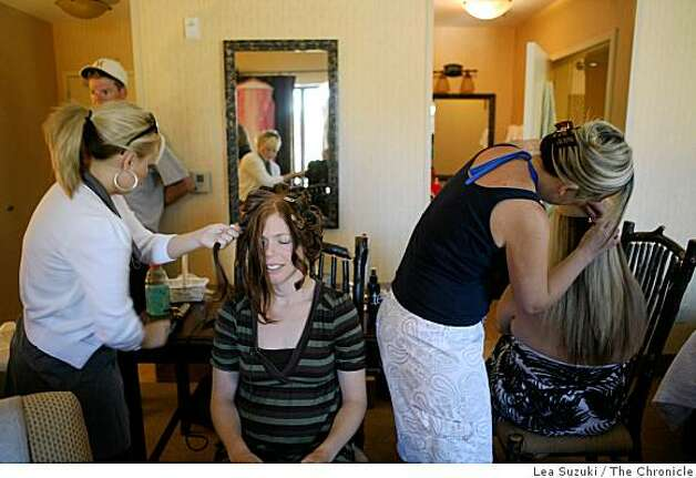 Carrie Shellhammer (second from left) has her hair done by stylist Lindsay Medina (left) in her hotel room in preparation for her wedding in Truckee, Calif. on Saturday, August 9, 2008. Photo: Lea Suzuki, The Chronicle