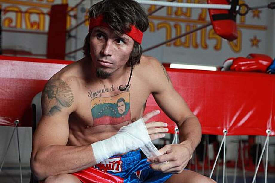 In this image released by Showtime, boxer Edwin Valero, of Venezuela, wraps his hand before a work out at Thai Champ Ringside Gym on Wednesday, Feb. 3, 2010, in Monterrey, Mexico. Valero will defend his WBC lightweight title on Saturday in Monterrey against Antonio DeMarco,of Mexico Photo: Tom Casino, AP