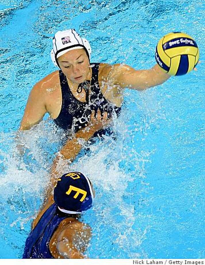BEIJING - AUGUST 11:  Kami Criag #12 of the United States looks to move the ball against Liu Ping #3 of China during their preliminary round water polo match at the Ying Tung Natatorium on Day 3 of the Beijing 2008 Olympic Games on August 11, 2008 in Beijing, China.  (Photo by Nick Laham/Getty Images) Photo: Getty Images