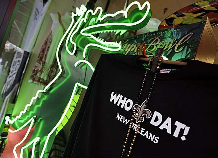 "FILE - In this Thursday, Jan. 21, 2010 file photo, a store front displays ""Who Dat!"" t-shirts for sale  in New Orleans. Who owns ""Who Dat""? Some T-shirt makers are asking that question after the NFL demanded they stop selling shirts with the traditional cheer of New Orleans Saints fans. Louisiana's attorney general said Monday Feb. 1, 2010, that shops can sell T-shirts with the phrase ""Who Dat"" and the fleur-de-lis symbol if they don't make other references to the New Orleans Saints or the National Football League. Photo: David J. Phillip, AP"
