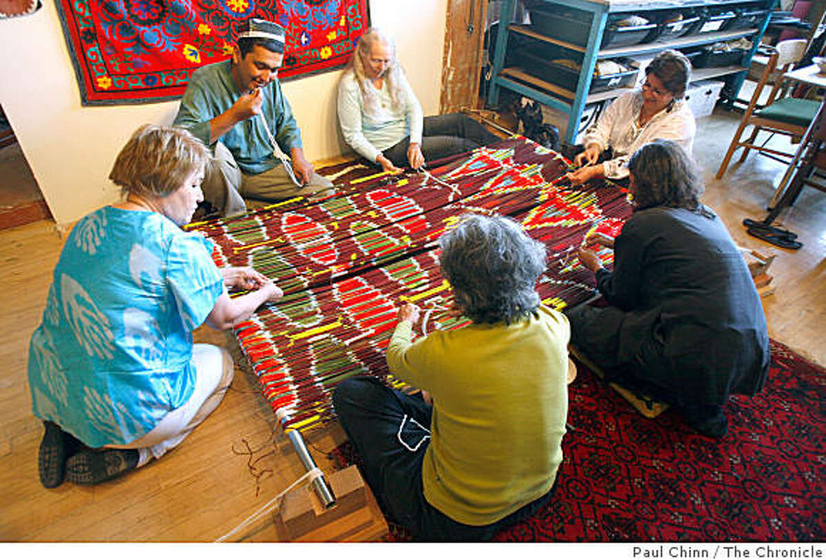 Rasul Mirzaahmedov, top left, a master weaver from Uzbekistan, teaches the art of ikat weaving to a small group of students attending a three-day workshop in San Francisco, Calif., on Saturday, July 19, 2008.Photo by Paul Chinn / The Chronicle
