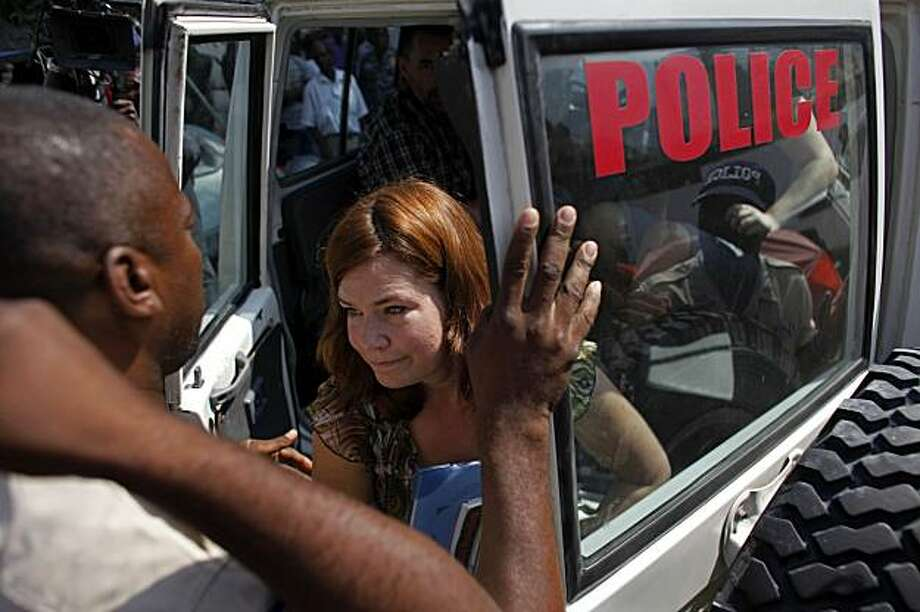Laura Silsby, 40, of Meridian, Idaho, one of the 10 Americans who were arrested while trying to bus children out of Haiti without proper documents or government permission, exits a police car upon her arrival to the court building in Port-au-Prince, Monday, Feb. 8, 2010. Five of the ten Americans were brought to court for a third time for questioning. Photo: Javier Galeano, AP