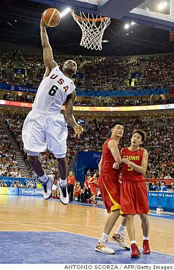 Basketball player LeBron James of the US scores as Yao Ming (C) and Liu Wei of China watch during their men's preliminary group B basketball match at the Olympic basketball arena during the 2008 Beijing Olympic Games on August 10, 2008.   AFP PHOTO/ANTONIO SCORZA (Photo credit should read ANTONIO SCORZA/AFP/Getty Images) Photo: ANTONIO SCORZA, AFP/Getty Images