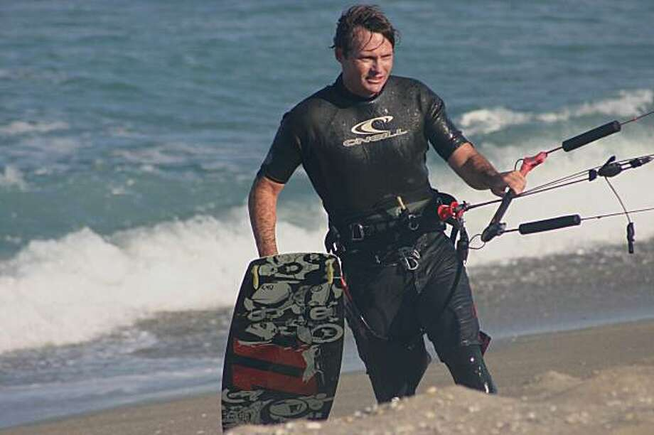 A 2007 photo provided by Chris Shultz shows Stephen Schafer coming out of the water after kiteboard surfing. Schafer, 38, was was fatally attacked by sharks off a Stuart, Fla., beach Wednesday, Feb 3, 2010. Schafer was the first person killed in a shark attack in Florida in five years, experts said. (AP Photo/Marketing Concepts, Chris Shultz) MANDATORY CREDIT; CHRIS SHULTZ Photo: Chris Shultz, AP