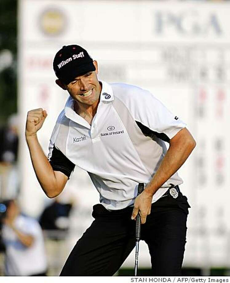 Padraig Harrington of Ireland pumps his fist as he sinks a putt and wins the 90th PGA Championship on August 10, 2008 at Oakland Hills Country Club in Bloomfield Township, Michigan. Harrington becomes the 2008 British Open and PGA Champion.  AFP PHOTO/Stan HONDA (Photo credit should read STAN HONDA/AFP/Getty Images) Photo: STAN HONDA, AFP/Getty Images