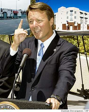 Former U.S. Sen. John Edwards from North Carolina gives a news conference held with Mayor Antonio Villaraigosa, not pictured, announcing the creation of the New Generation Fund, a $100 million addition to the city's affordable housing finance system, on Monday, July 21, 2008 downtown Los Angeles. In the background are photos of the Yankee building before and after being transformed into low income apartments. (AP Photo/Damian Dovarganes) Photo: Damian Dovarganes, AP