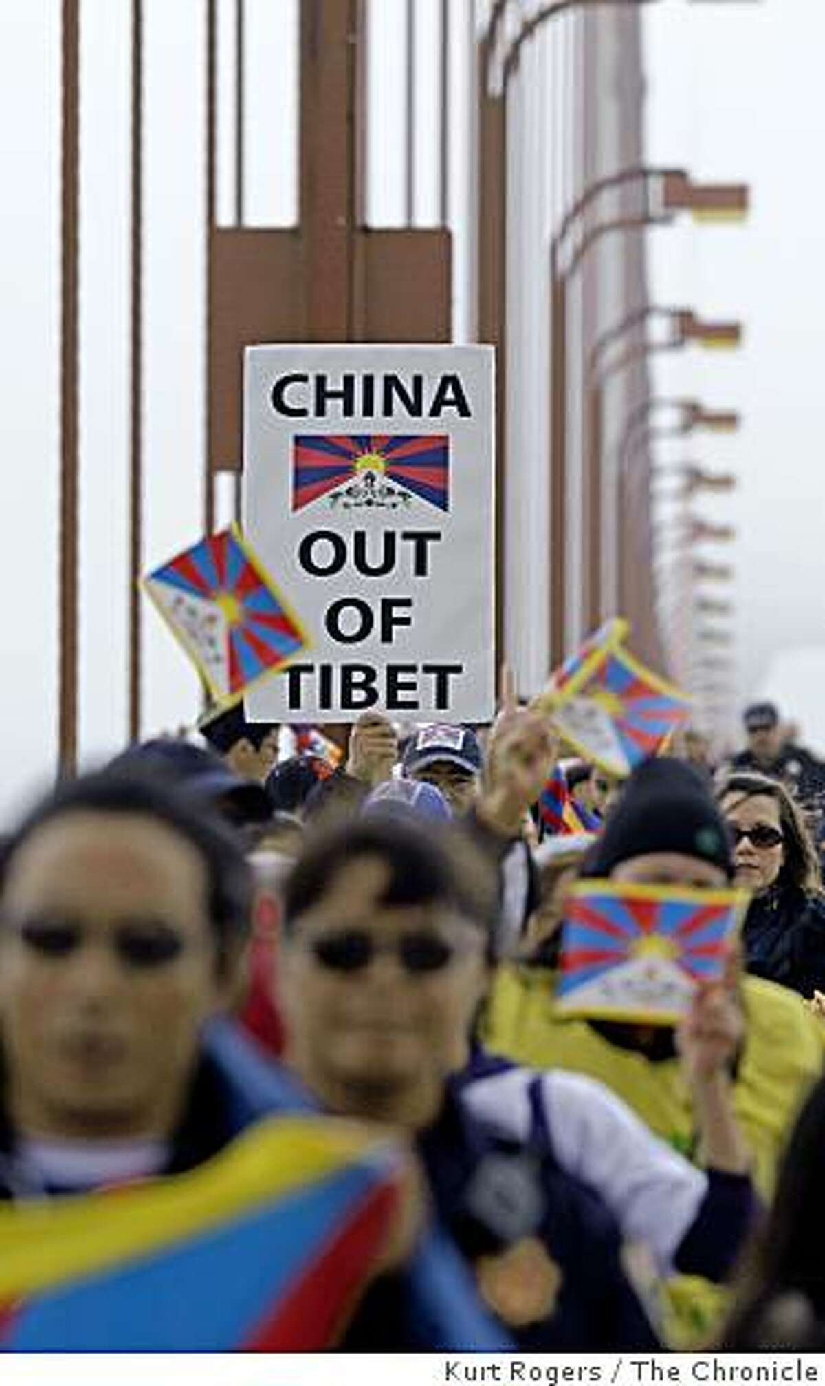 A few hundred protesters calling attention to human rights conditions in Tibet march over the Golden Gate Bridge.