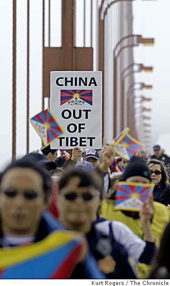 A few hundred protesters calling attention to human rights conditions in Tibet march over the Golden Gate Bridge. Photo: Kurt Rogers, The Chronicle