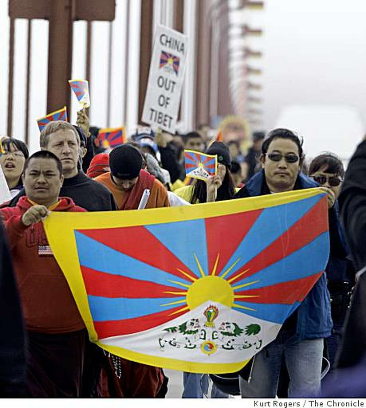 A few hundred protesters calling attention to human rights in Tibet march over the Golden Gate Bridge.