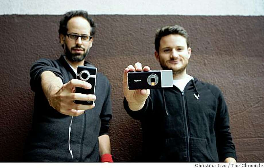 Carlton Evans, left, and Eric Slatkin, are the creators of Disposable Film Fest which showcases videos and films made with nontraditional cameras such as the ones they're holding on Monday, August 4, 2008, San Francisco, Calif. Photo: Christina Izzo, The Chronicle
