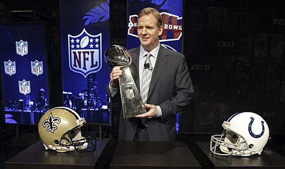 NFL Commissioner Roger Goodell holds the Vince Lombardi Trophy after a news conference Friday, Feb. 5, 2010 in Fort Lauderdale, Fla. The New Orleans Saints will play the Indianapolis Colts in Super Bowl XLIV Sunday, Feb. 7, at Sun Life Stadium in Miami. Photo: David J. Phillip, AP