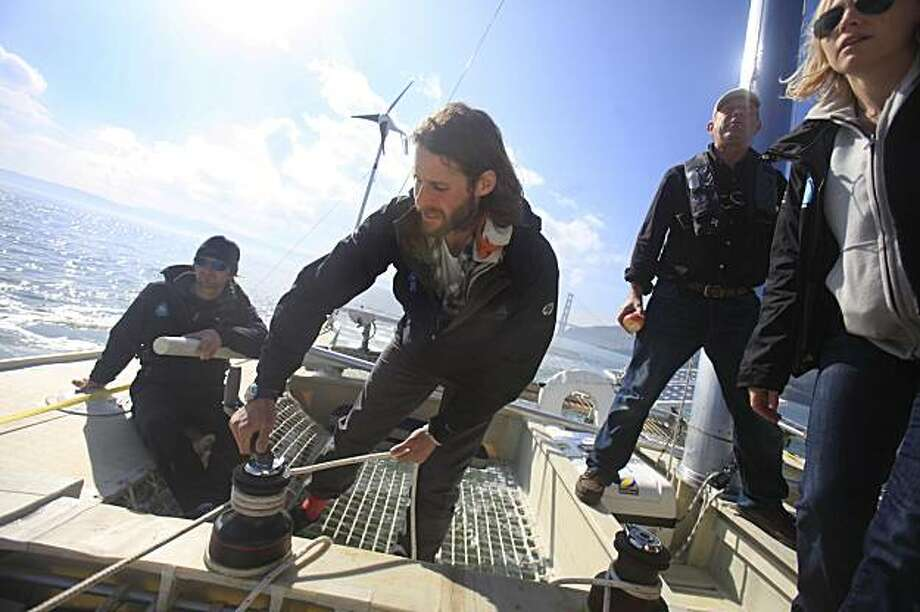 David de Rothschild (second from left), founder of Adventure Ecology, trims the sails on the Plastiki while sailing on the San Francisco bay on Wednesday, February 3, 2010.  The Plastiki, whose mission is to beat waste, is a catamaran boat that uses 12,500 plastic bottles in it's construction and will be sailing from San Francisco to Sydney, Australia in March. Photo: Lea Suzuki, The Chronicle