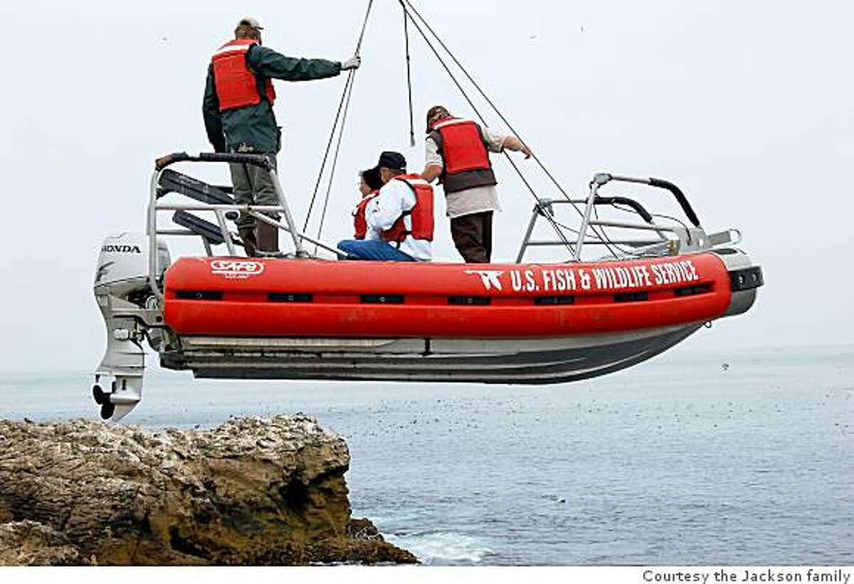 Del and Lucky Jackson, seated, of Alameda, Calif., are hoisted from the ocean onto the Farallon Islands on Friday, August 8, 2008 as they visited their former home on the islands for the first time in 55 years. The Jacksons lived on southeast Farallon Island from 1953-54, when Lucky Jackson served as a lighthouse keeper for the Coast Guard .