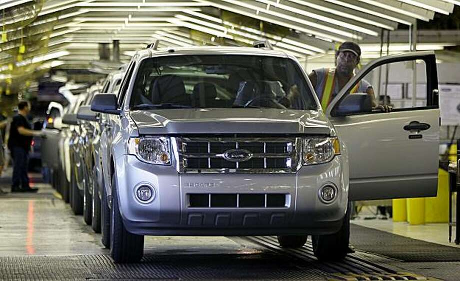 FILE - In this Aug. 26, 2009 file photo, new Ford Escape SUVs roll off the line at Ford's Kansas City Assembly Plant in Claycomo, Mo. Ford Motor Co. said Wednesday, Feb. 3, 2010, that it's Escape sports utility model has qualified for Japanese governmentincentives for green vehicles, following criticism that the program was shutting out American automakers. Photo: Charlie Riedel, AP