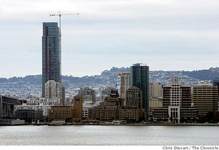 A number of new glass towers are being built in San Francisco including the Infinity (at right) - one of two luxury condominium towers of curved glass now under construction at Spear and Folsom streets. It is dwarfed by the taller One Rincon Hill at 425 First Street at Harrison Street. Photographed October 9, 2007 Photo: Chris Stewart, The Chronicle