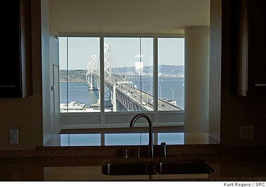 Buyers at One Rincon Hill, the 64-story building that soars above the western approach to the Bay Bridge, have completed the sale of 192 units in its 376-unit first phaseLooking out one of the kitchen windows at One Rincon at the Bay Bridge in San Francisco on March 4,2008Photo By Kurt Rogers / San Francisco Chronicle Photo: Kurt Rogers, SFC