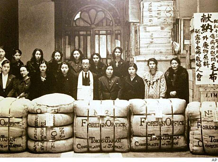 **APN ADVANCE FOR SUNDAY AUG. 10 **  In this photo provided by the Museum of Japanese Migration to Peru, Japanese migrants stand by aid packages to be sent to Japanese soldiers, in Lima,  Dec. 1941.   During the World War II, thousands of men, women and children of Japanese ancestry were plucked from their homes in Latin America and forced into internment camps in the far-off US.(AP Photo/Museum of Japanese migration to Peru) Photo: AP