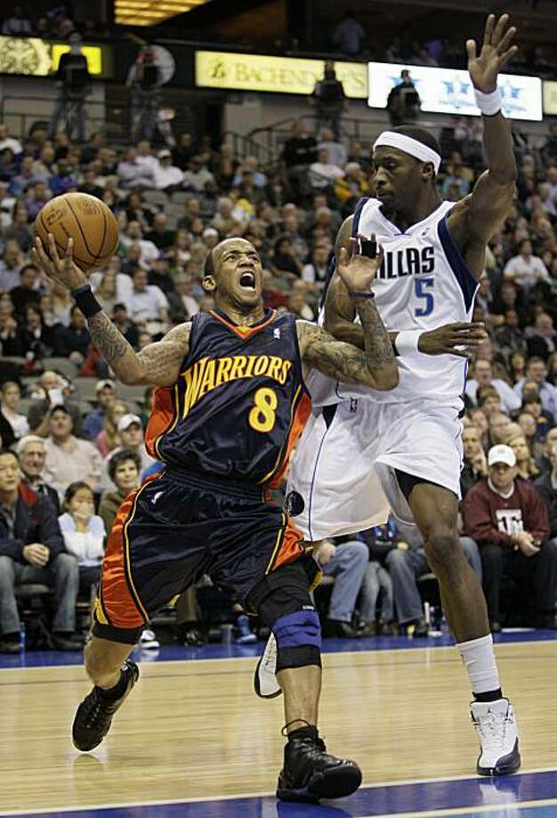 Dallas Mavericks forward Josh Howard (5) defends as Golden State Warriors guard Monta Ellis (8) drives to the basket in the first half of an NBA basketball game, Wednesday, Feb. 3, 2010, in Dallas. Photo: Tony Gutierrez, AP