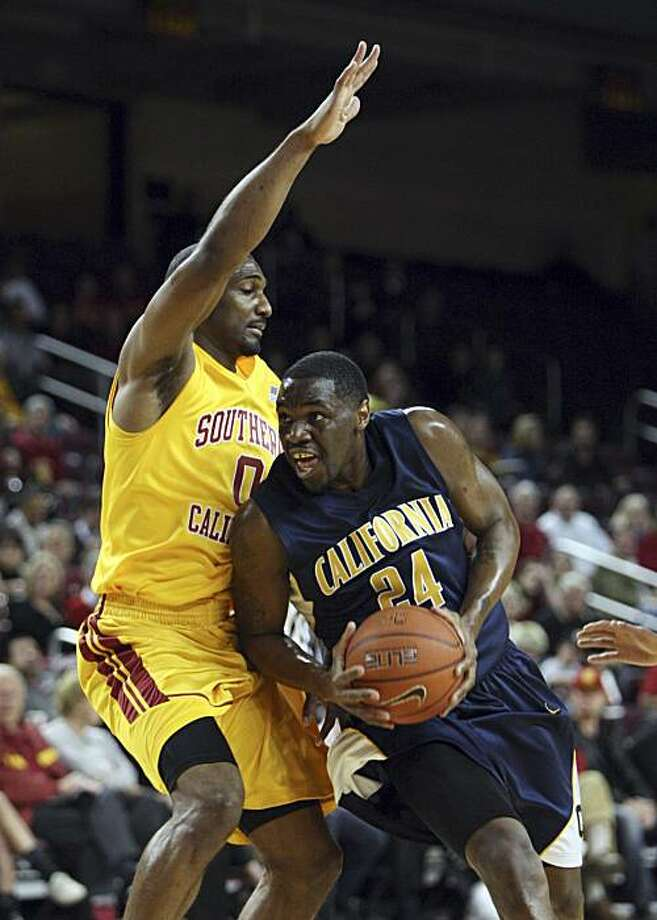 California's Theo Robertson drives past Southern California's Marcus Johnson is  in the first half of an NCAA basketball game in Los Angeles on Thursday, Feb. 4, 2010. (AP photo/Christine Cotter) Photo: Christine Cotter, AP