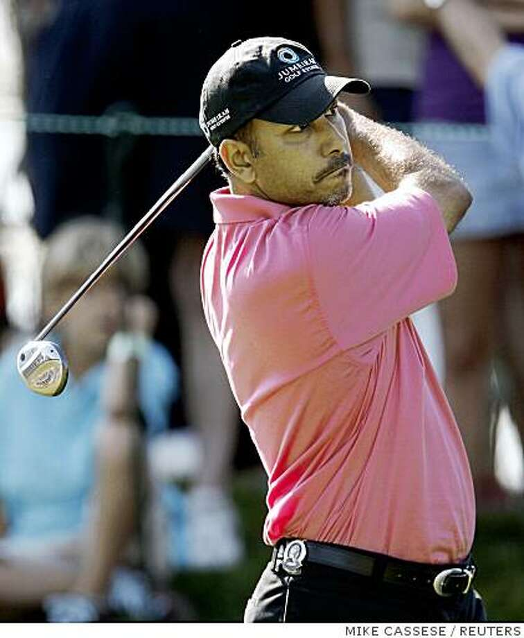 Jeev Milkha Singh of India watches his tee shot on the 9th hole during the first round of the 90th PGA Championship golf tournament at the Oakland Hills Country Club in Bloomfield Township, Michigan August 7, 2008.     REUTERS/Mike Cassese (UNITED STATES) Photo: MIKE CASSESE, REUTERS