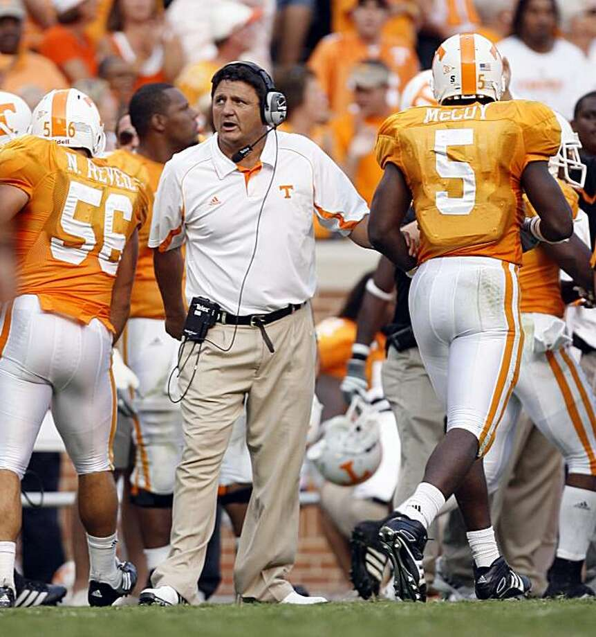 KNOXVILLE, TN - SEPTEMBER 12: Ed Orgeron, assistant head coach of the Tennessee Volunteers congratulates Rico McCoy #5 of the Tennessee Volunteers against the UCLA Bruins on September 12, 2009 at Neyland Stadium in Knoxville, Tennessee. UCLA beat Tennessee 19-15. (Photo by Joe Murphy/Getty Images) Photo: Joe Murphy, Getty Images