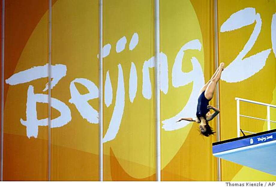 A diver leaps during a training session in the National Aquatics Center at the Beijing 2008 Olympics in Beijing, Wednesday, Aug. 6, 2008. (AP Photo/Thomas Kienzle) Photo: Thomas Kienzle, AP