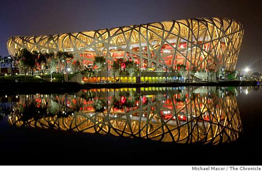 The National Stadium glows in all it's colors, on Tuesday Aug. 05, 2008, with final rehersals taking place inside as Beijing, China is set for the opening ceremonies of the 2008 Olympics on Friday. Photo: Michael Macor, The Chronicle