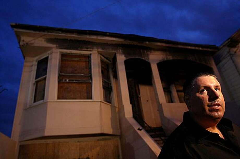 Christopher Posey-Mora from San Francisco Fire Department stands in front of a burned house on Felton Street where he was severely injured a year ago while fighting an arson fire. San Francisco on Friday. Photo: Jana Asenbrennerova, The Chronicle
