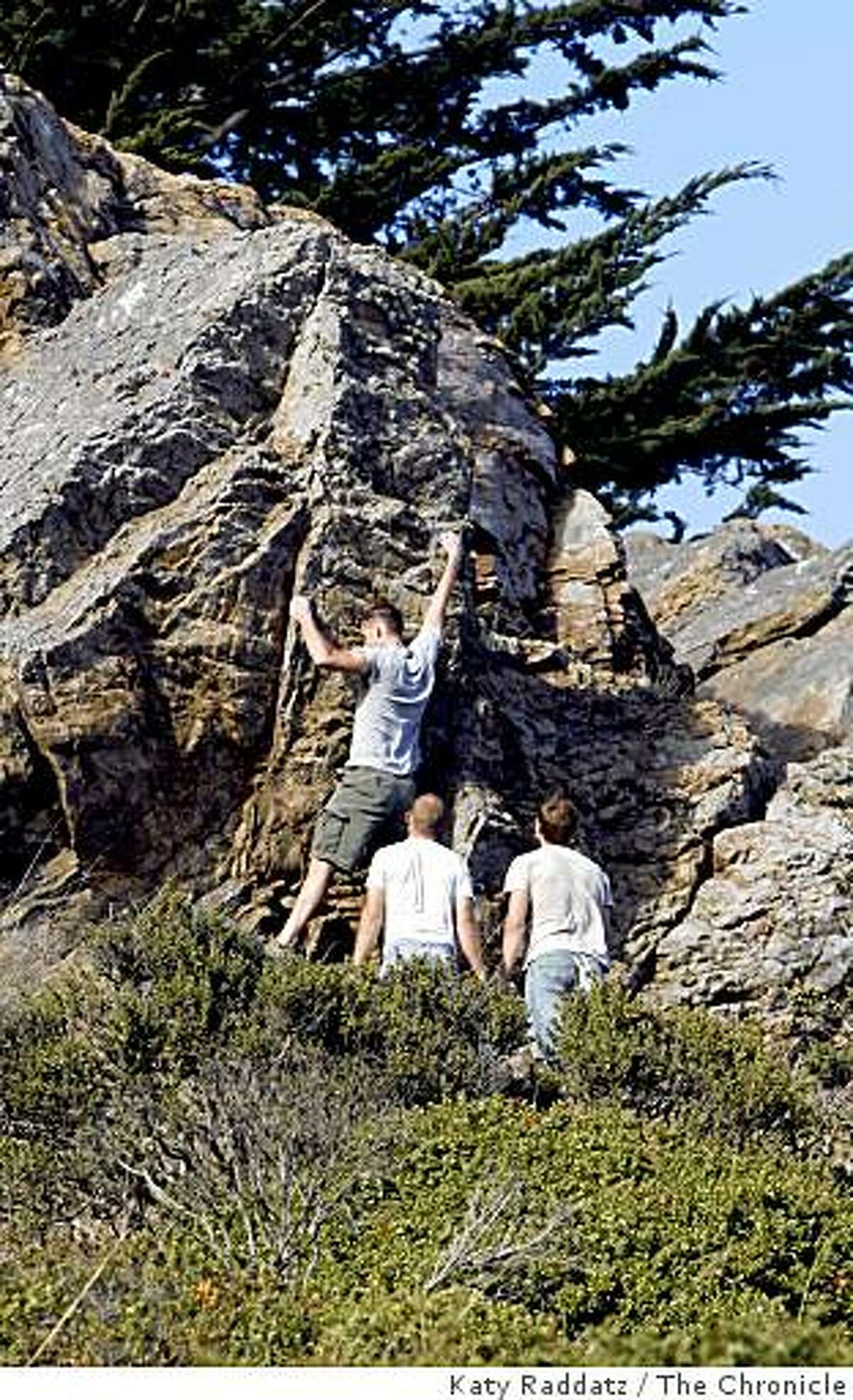 Rock climbers practice bouldering on one of the chert outcroppings in Glen Canyon, in San Francisco, Calif. Sunday, Aug. 3, 2008.