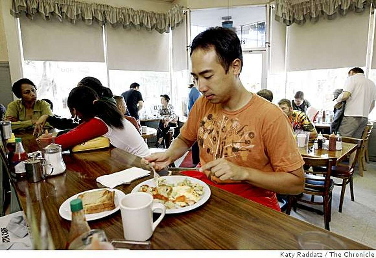 Lawrence Huang enjoys breakfast at Tyger's Coffee Shop in the Glen Park neighborhood of San Francisco, Calif. Sunday, Aug. 3, 2008.