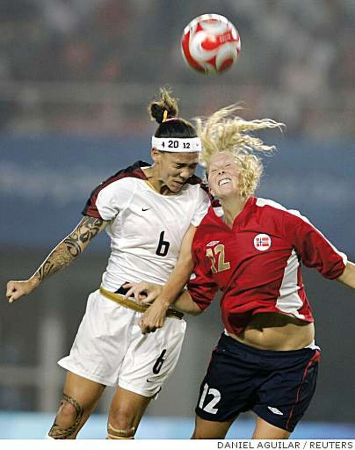 Natasha Kai of the U.S. (L) and Marit Fiane Christensen of Norway fight for the ball during their first round Group G women's soocer match of the Beijing 2008 Olympic Games at Qinhuangdao Olympic Sports Center Stadium August 6, 2008.     REUTERS/Daniel Aguilar (CHINA) Photo: DANIEL AGUILAR, REUTERS