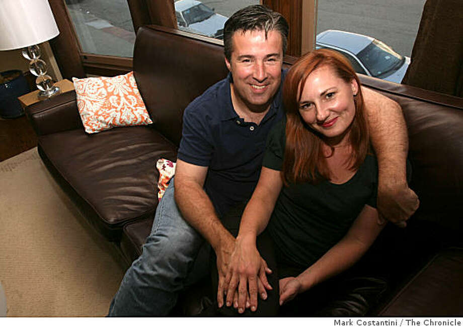 Kevin Phelan  and Michelle Richmond pose at home in San Francisco , Calif., on Thursday, July 10, 2008.    Photo by Mark Costantini  /  The Chronicle. Photo: Mark Costantini, The Chronicle