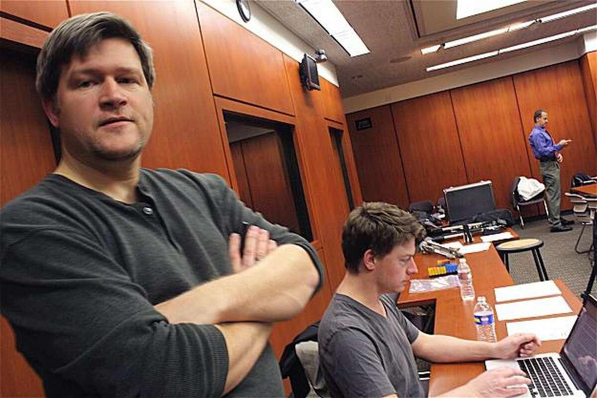 Co-producers John Ireland, left, and John Ainsworth, right, prepare the script on-set.