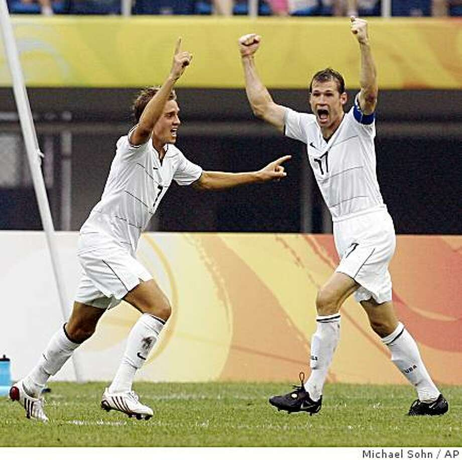 Stuart Holden, left, and his teammate Brian McBride, celebrate Holden's goal during a men's Group B, first round soccer match between Japan and the USA at the Beijing 2008 Olympics in Tianjin, China, Thursday, Aug. 7, 2008. Photo: Michael Sohn, AP
