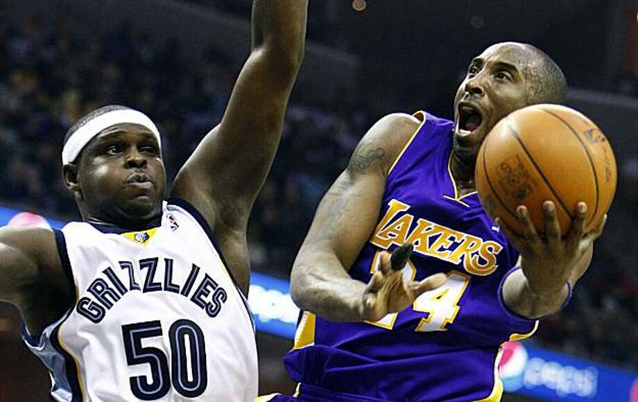 Los Angeles Lakers'  Kobe Bryant, right, drives to the basket against Memphis Grizzlies'  Zach Randolph, left, during the first half of an NBA basketball game in Memphis, Tenn., Monday, Feb. 1, 2010. Photo: Mark Weber, AP