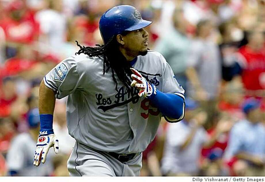 ST. LOUIS, MO - AUGUST 7: Manny Ramirez #99 of the Los Angeles Dodgers watches his two-run home run against the St. Louis Cardinals at Busch Stadium August 7, 2008 in St. Louis, Missouri. The Dodgers beat the Cardinals 4-1.  (Photo by Dilip Vishwanat/Getty Images) Photo: Dilip Vishwanat, Getty Images