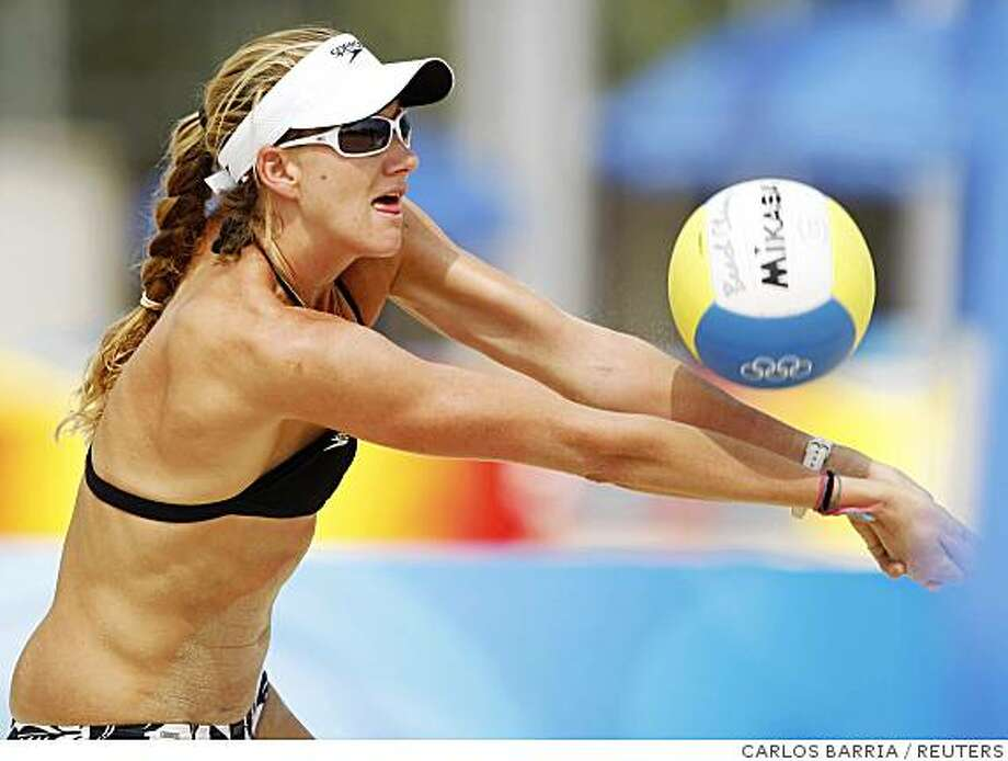 Kerry Walsh of the United States returns a ball to her team mate Misty May-Treanor as they practice in the Beijing 2008 Olympic Beach Volleyball Center August 5, 2008.     REUTERS/Carlos Barria (CHINA) Photo: CARLOS BARRIA, REUTERS