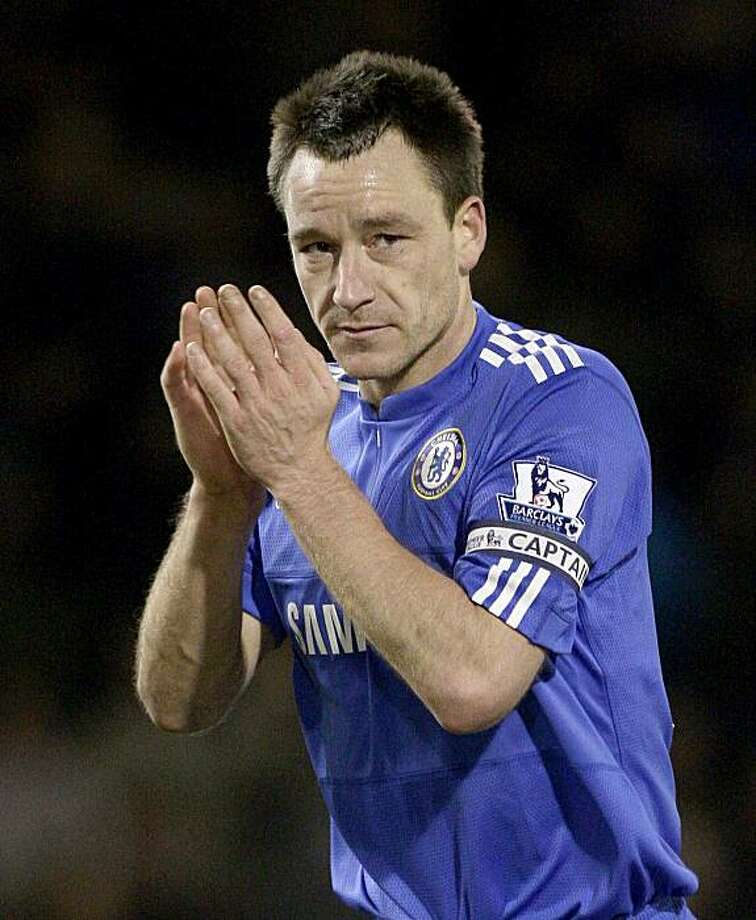Chelsea's captain John Terry applauds supporters after his team's English Premier League soccer match against Burnley at Turf Moor Stadium, Burnley, England, Saturday Jan. 30, 2010. Terry scored the winning goal in his team's 2-1 win. Photo: Jon Super, AP