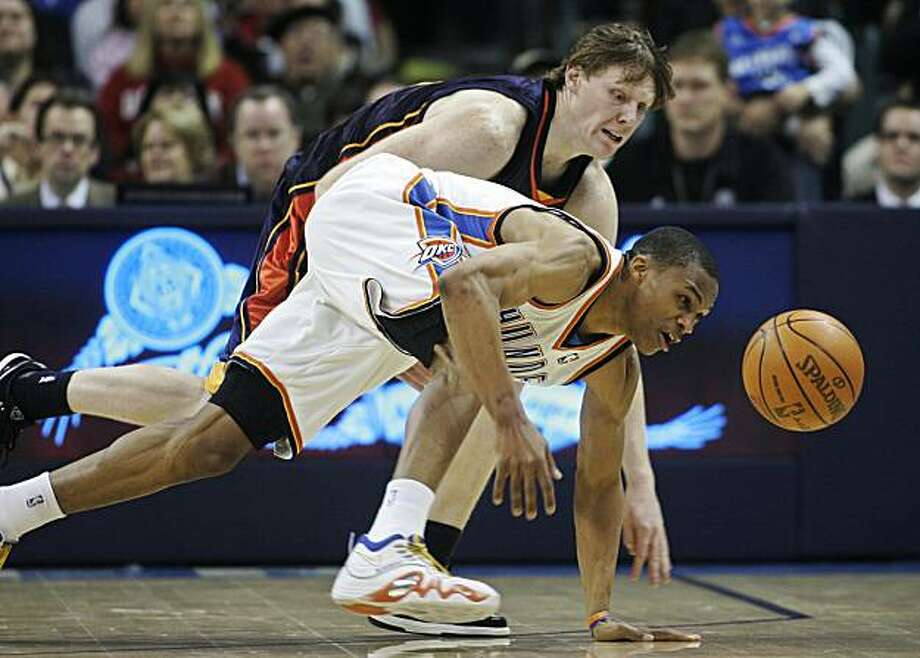 Oklahoma City Thunder guard Russell Westbrook, front, and Golden State guard Coby Karl, rear, chase a loose ball in the third quarter of an NBA basketball game in Oklahoma City, Sunday, Jan. 31, 2010. Oklahoma City won 112-104. Photo: Sue Ogrocki, AP