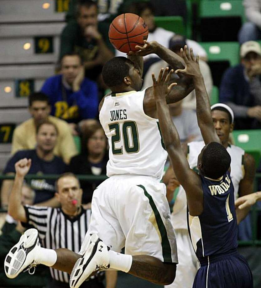 South Florida's Dominique Jones (20) is fouled on a shot by Pittsburgh's Travon Woodall during the first half of an NCAA college basketball game Sunday, Jan. 31, 2010, in Tampa, Fla. Photo: Mike Carlson, AP