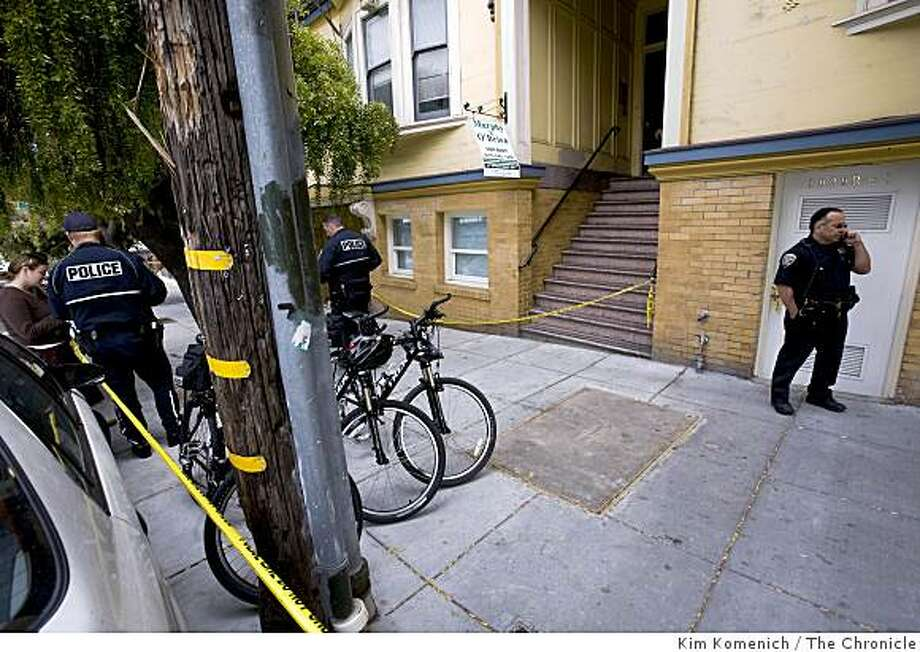 Officers stand outside an apartment building on the 1400 block of 15th Street in San Francisco, Calif., where a 60 year-old woman was shot, allegedly by a San Francisco police officer,  on Thursday, Aug. 5, 2008. Photo: Kim Komenich, The Chronicle