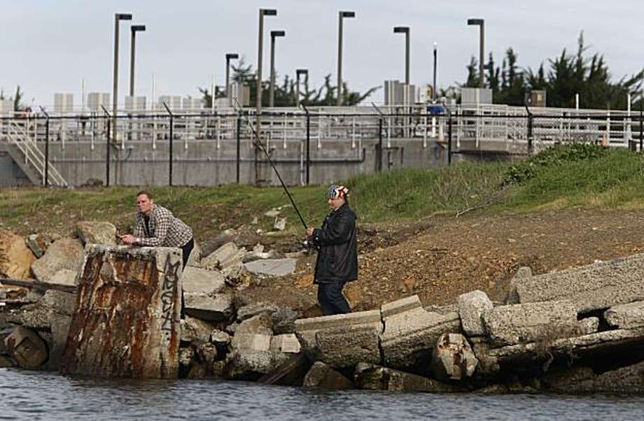 A man goes fishing along the shoreline in front of the Point Isabel wet weather facility managed by EBMUD in Richmond, Calif., on Thursday, Jan. 28, 2010. The watchdog group San Francisco Baykeeper is concerned about the large amounts of partially treated rain water discharged into the bay from the facility. Photo: Paul Chinn, The Chronicle