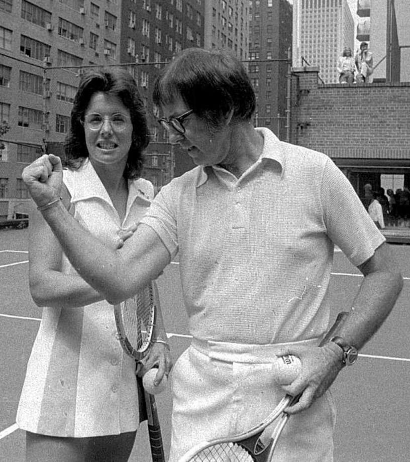 """ADVANCE FOR WEEKEND EDITONS, APRIL 22-23 **  FILE ** This is an undated handout showing Bobby Riggs posing for Billie Jean King. Riggs proudly proclaimed himself a male chauvinist pig as he hyped the 'Battle of the Sexes,"""" played Sept. 20, 1973 at the Houston Astrodome. (AP Photo/File)Ran on: 04-23-2006 Photo: Ap, File, 1973"""