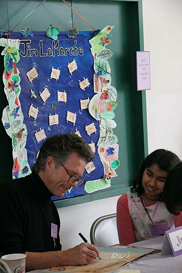 Author and illustrator Jim La Marche shares a drawing with a student docent at a previous festival. Photo: Kristen Blake