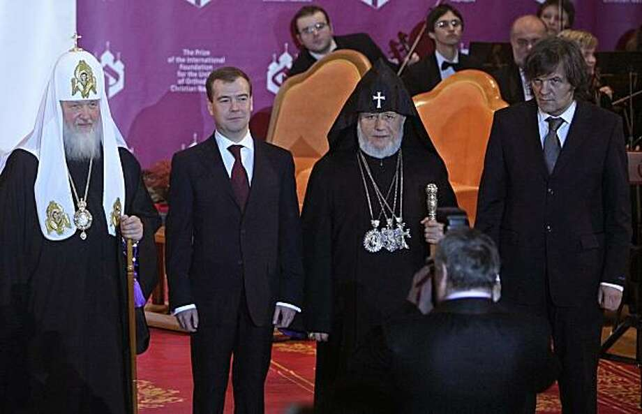 Patriarch of Moscow and All Russia Kirill  (1sL) poses for a picture with  Russian President Dmitry Medvedev (2L), Cathalicos Karekin II of All Armenians (2R) and Serbian film director Emir Kusturica (R) after they were awarded a  prize in memory of the late Patriarch Alexy II of Moscow and All Russia at the Cathedral of Christ the Savior in Moscow on January 21, 2010. Named after Patriarch Alexy II, the prize is the most prestigious award in the Orthodox world. Photo: Maxim Shipenkov, AFP/Getty Images