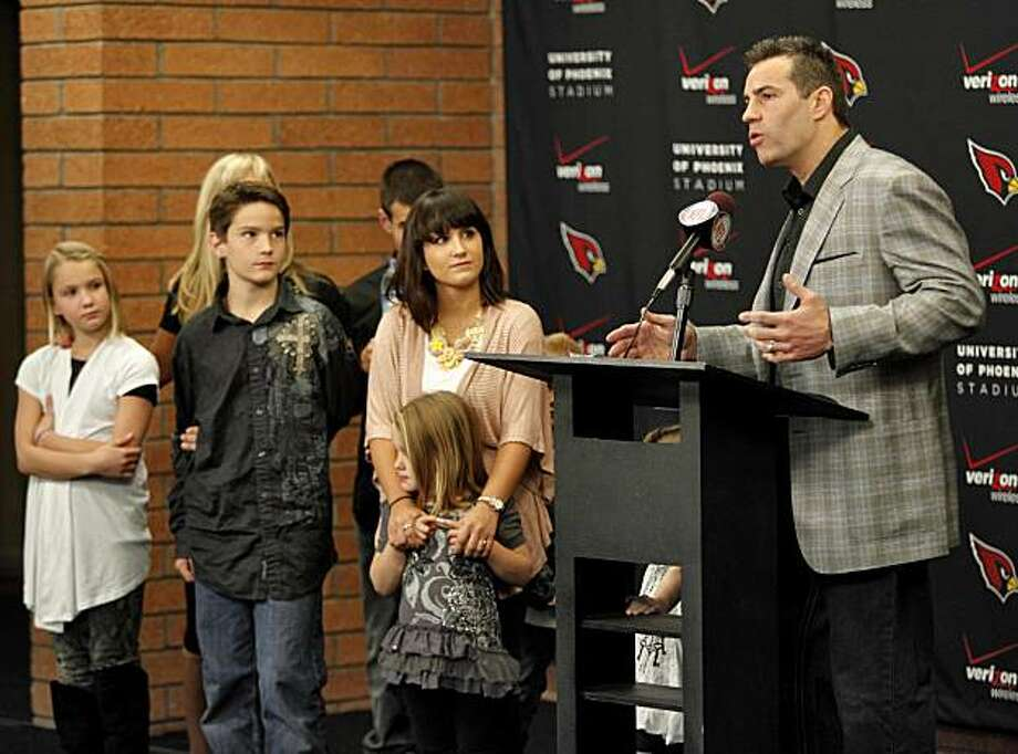 Arizona Cardinals quarterback Kurt Warner announces his retirement from football with his family Friday, Jan. 29, 2010 at the Cardinals' training facility in Tempe, Ariz. Photo: Matt York, AP