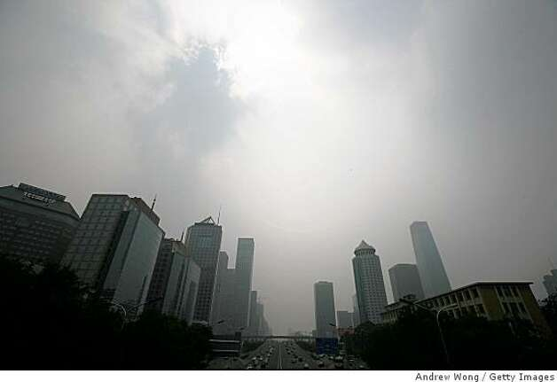 BEIJING - JULY 28:  A general view of the Central Business District which is shrouded with heavy smog on July 28, 2008 in Beijing, China. Pollution levels remained high just 11 days before the Olympics. The Chinese capital could ban 90 percent of private cars from its roads and closing more factories in a last-ditch bid to clear smoggy skies for the Olympics, state media reported on Monday. (Photo by Andrew Wong/Getty Images) Photo: Getty Images