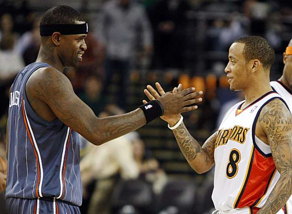 Golden State Warriors' Monta Ellis, right, greets former teammate Charlotte Bobcats' Stephen Jackson prior to their game Friday in Oakland.
